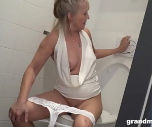 Blonde granny puts rest room..